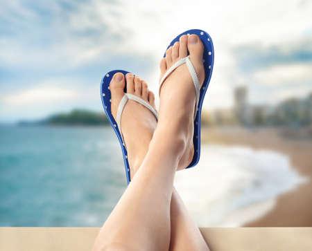 Woman relaxing on beach, closeup. Summer vacation concept