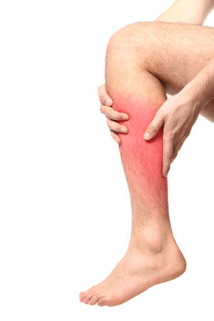 Health care concept. Man suffering from pain in calf on white background