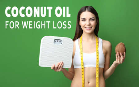 Young woman holding nut and scales on green background. Coconut oil for weight loss