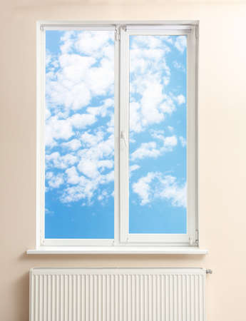 View of blue sky through modern window in room Stock Photo