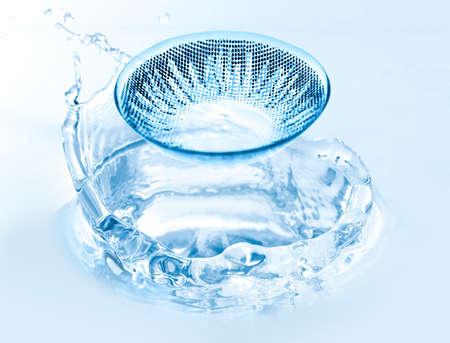 Eyesight correction concept. Contact lens and water splash, closeup