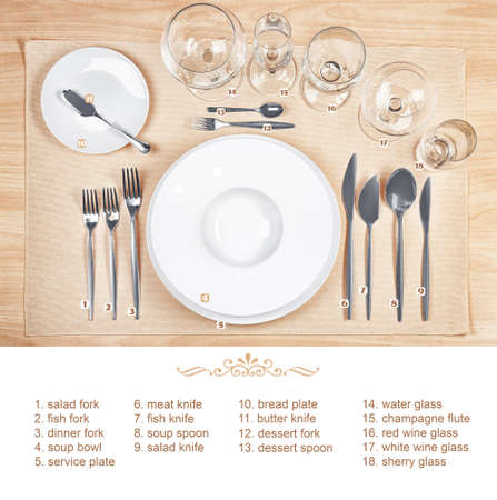 Arrangement of dishware and cutlery on wooden background. Table setting rules and etiquette Archivio Fotografico