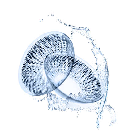 Eyesight correction concept. Contact lenses and water splashes on white background