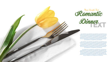 Cutlery, tulip and napkin with space for text on white background, closeup