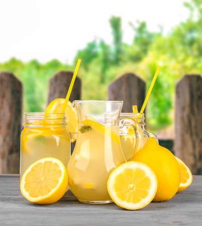 Tasty lemonade in glassware on blurred background Stock Photo