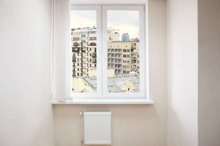 Cityscape view through modern window in room