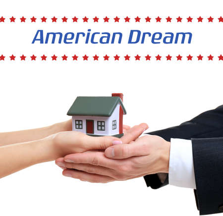 Text AMERICAN DREAM and people holding house model on white background