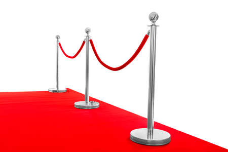 Red carpet and rope barrier on white background