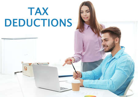 Tax deductions concept. People working in office