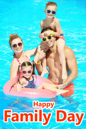 Parents with little children in swimming pool. Happy family day concept