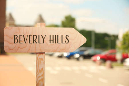 Direction sign to BEVERLY HILLS on street. Travel USA concept Stock Photo