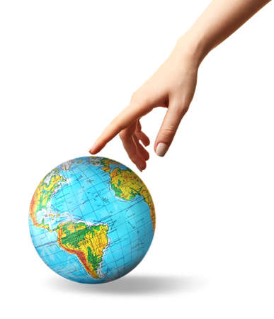 Woman pointing on globe, white background. Concept of global leadership and geopolitics Stock Photo