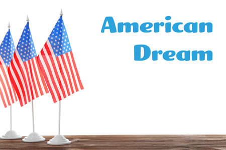 Text AMERICAN DREAM and USA flags on white background