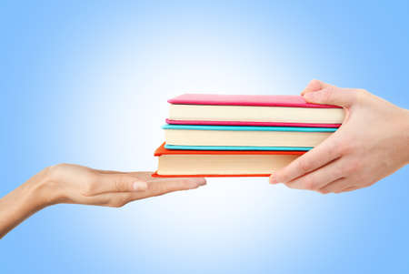 Concept of right to education. Female hands with books on color background