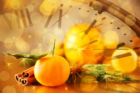 Countdown to Christmas celebration. Double exposure of clock and composition with tangerine