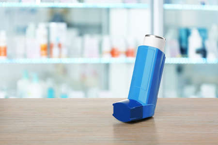 Concept of health care and asthma. Inhaler on counter at pharmacy