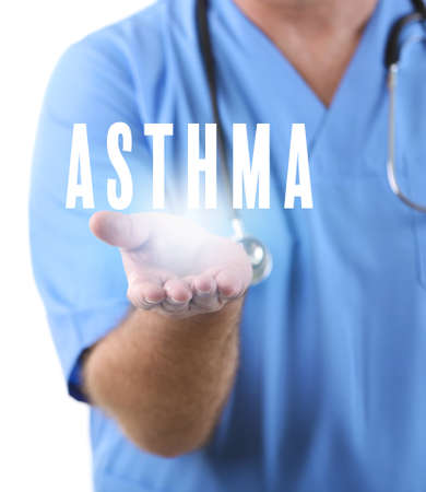Health care concept. Doctor holding word ASTHMA, closeup Stock Photo