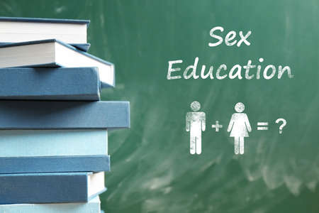 Sex education concept. Books and blackboard on background