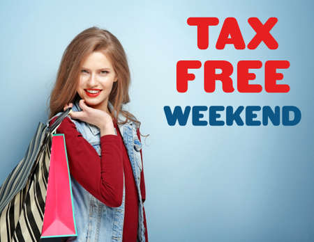 Young woman with paper bags and text TAX FREE WEEKEND on color background