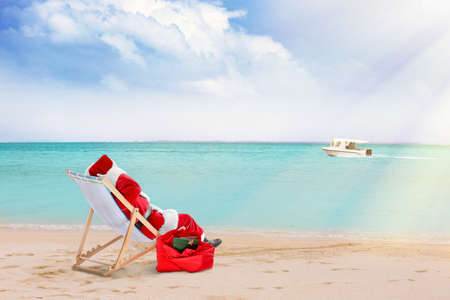 Santa Claus relaxing on sea shore. Christmas and New Year vacation
