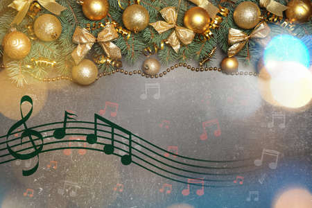 Composition with festive decorations and notes on grey background. Concept of Christmas music and songs