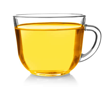 Glass cup of cooking oil on white background Foto de archivo