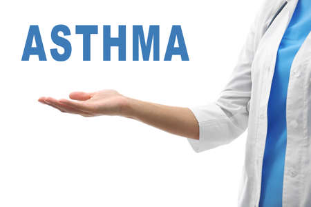 Health care concept. Doctor holding word ASTHMA on white background