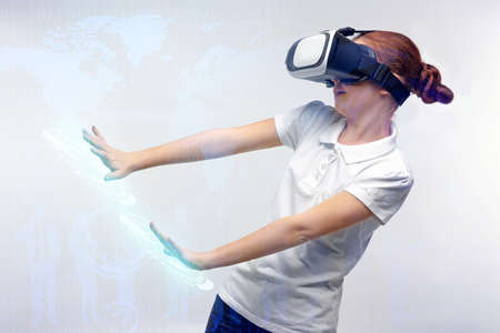 Girl with virtual reality glasses on light background. Concept of school and modern technology