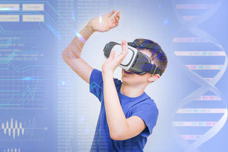 Boy with virtual reality glasses on color background. Concept of school and modern technology