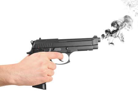 Man holding smoking gun on white background Stock Photo