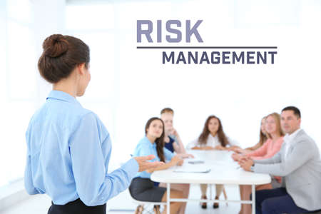 Concept of risk management. Business trainer with team of managers on meeting Stock Photo