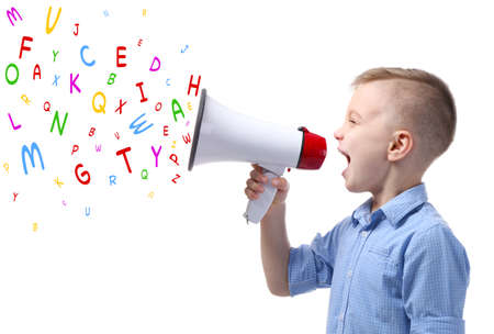Little boy with megaphone and letters on white background. Speech therapy concept