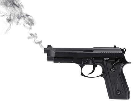 Smoking gun on white background