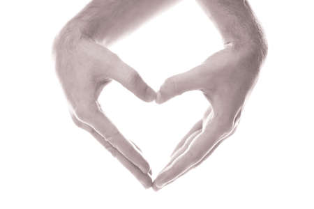 Gay couple making heart with hands on white background