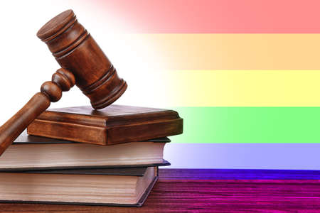 Judges gavel and books on wooden table. Gay rights concept