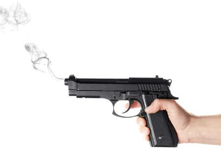 Man holding smoking gun on white background