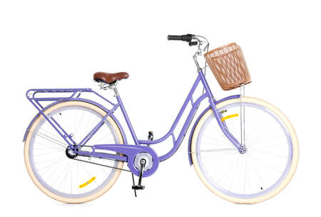 Modern bicycle with basket on white background
