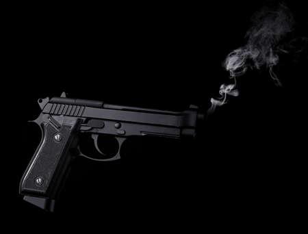 Smoking gun on black background