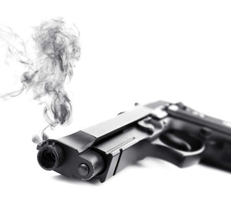 Smoking gun on white background, closeup