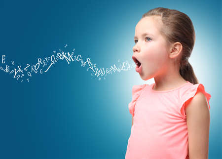 Little girl and letters on color background. Speech therapy concept Stockfoto