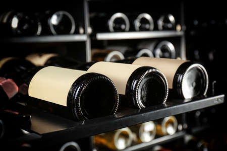 Bottles of wine on shelf at store, closeup Stok Fotoğraf - 92271543
