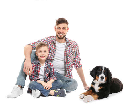 Father and son with dog on white background
