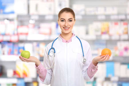 Nutritionist with fruits at pharmacy