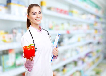 Nutritionist with pepper and clipboard at pharmacy