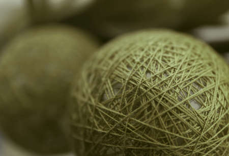 Green ball of thread on blurred background, closeup Stock Photo