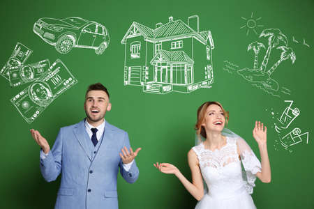 Happy wedding couple dreaming about future and drawings on color background