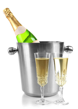 Bottle of champagne in bucket and glasses of champagne, isolated on white