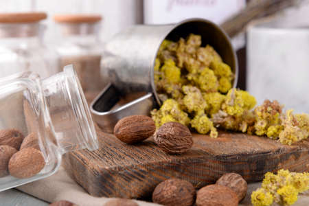 Dried herbs with nutmeg on table close up Standard-Bild