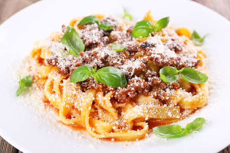 Pasta Bolognese with parmesan and basil on plate close up Stock Photo