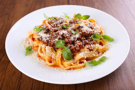 Pasta Bolognese with parmesan and basil on table close up Imagens